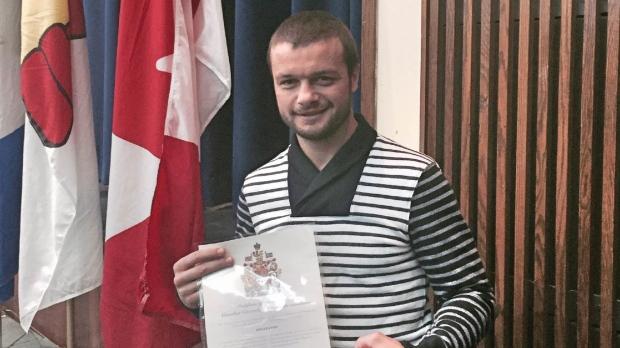 Ionut (Jo Jo) Dan poses with Canadian citizenship