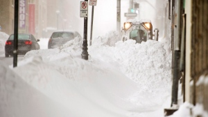 A plow clears the sidewalk in Halifax, Canada on Wednesday, March 18, 2015. (Andrew Vaughan / THE CANADIAN PRESS)