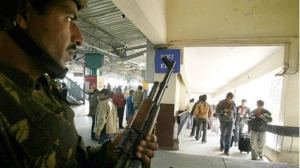 A Jammu and Kashmir police officer stands guard at the railway station in Jammu, India. (AP / Channi Anand)