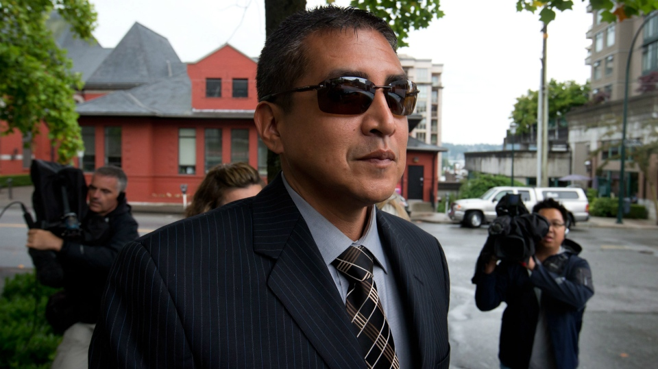 Former RCMP Cpl. Benjamin (Monty) Robinson leaves B.C. Supreme Court in New Westminster, B.C., on Friday July 20, 2012. (Darryl Dyck / THE CANADIAN PRESS)