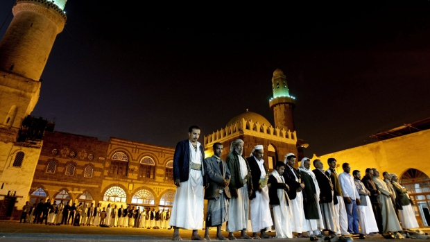 Praying at a mosque in Sanaa, Yemen