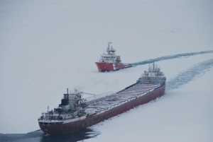 In this photo provided by the Canadian Coast Guard, the CCGS Samuel Risley escorts the MV Arthur M. Anderson on Lake Erie, Sunday, Feb. 22 2015.