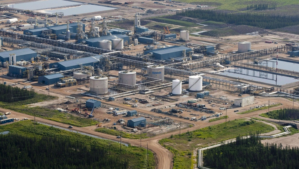 A Suncor oil sands facility is pictured near Fort McMurray, Alta., on July 10, 2012. (Jeff McIntosh/THE CANADIAN PRESS)