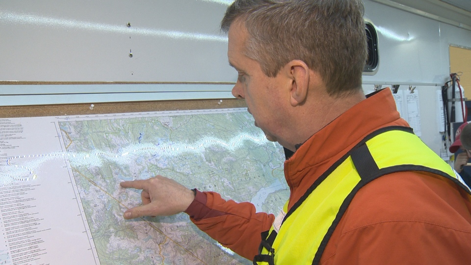 Paul Berry of Comox Valley SAR mapping out search areas in Strathcona Park to locate the missing 18-year-old.