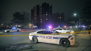 Police attend a scene of a shooting in Mississauga early Saturday March 21, 2015. (J. P. Moczulski / THE CANADIAN PRESS)
