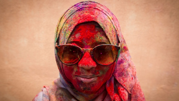 A Malaysian Muslim woman poses for a photo during the religious spring festival Holi in Kuala Lumpur, Malaysia on Saturday, March 21, 2015. (AP / Joshua Paul)
