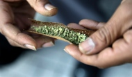 A man rolls a marijuana cigarette in Trenton, N.J. on March 21, 2015. (AP / Mel Evans)