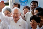 Singapore's Lee Kuan Yew waves to supporters as he arrives at an elections nomination center in Singapore in this April 27, 2011, file photo. (AP / Wong Maye-E)