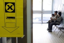 Voters wait their turn to cast their ballot in Montreal, on Tuesday Oct. 14. (Graham Hughes / THE CANADIAN PRESS)