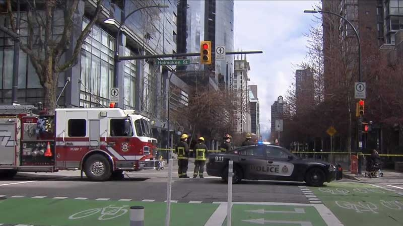 Police and firefighters respond to the discovery of a suspicious package near Hornby and Helmcken streets in downtown Vancouver. March 23, 2015. (CTV)