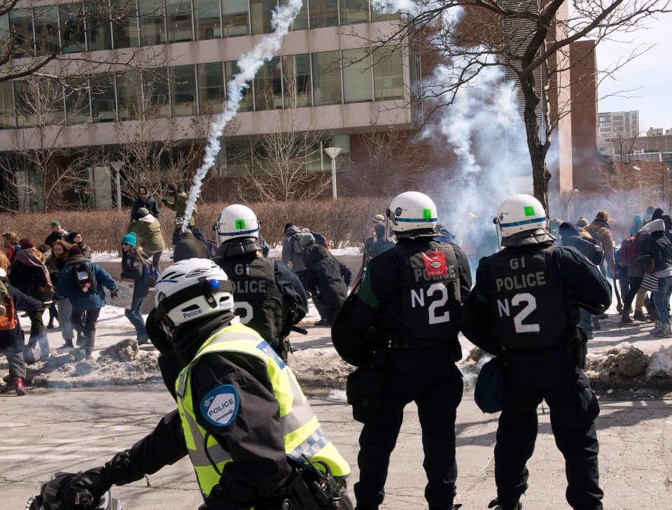 A smoke bomb is fired during a student demonstration against proposed austerity changes by the provincial government on March 23, 2015 in Montreal. (Ryan Remiorz / The Canadian Press)
