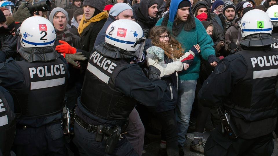 Police disperse demonstrators as students protest against proposed austerity changes by the provincial government, Monday, March 23, 2015 in Montreal. (Ryan Remiorz / THE CANADIAN PRESS)