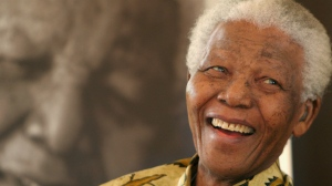 Former South African President, Nelson Mandela, smiles at the Mandela Foundation in Johannesburg on Dec. 7, 2005. (AP / Denis Farrell)
