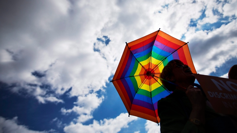A man holds a rainbow-coloured umbrella during a rally in Atlanta in this Tuesday, March 17, 2015 file photo. (AP / David Goldman)