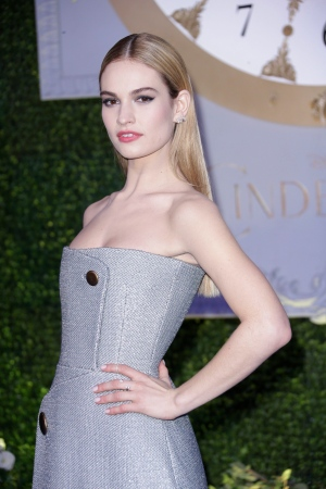 Lily James poses for photographers upon arrival at the premiere of the film Cinderella in London, Thursday, 19 March, 2015. (Joel Ryan / Invision)