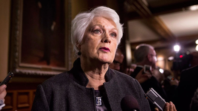 Ontario's Education Minister Liz Sandals scrums with the media following question period at Queen's Park in Toronto on Tuesday, March 3, 2015. (Chris Young / THE CANADIAN PRESS)