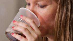 In this file photo, a woman sips a soft drink in New York, on June 27, 2012. (AP / Bebeto Matthews)