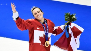 Canada's Marie-Philip Poulin waves the crowd after scoring the game winning goal to defeat the United States during sudden death overtime women's hockey final action at the 2014 Sochi Winter Olympics in Sochi, Russia on Thursday, February 20, 2014. (THE CANADIAN PRESS/Nathan Denette)