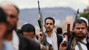 Shiite rebels, known as Houthis, hold up their weapons to protest against Saudi-led airstrikes, during a rally in Sanaa, Yemen, Thursday, March 26, 2015. (AP / Hani Mohammed)