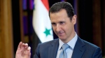 FILE - In this Tuesday, Feb. 10, 2015 file photo released by the Syrian official news agency SANA, Syrian President Bashar Assad gestures during an interview in Damascus, Syria. (AP Photo/SANA, File)