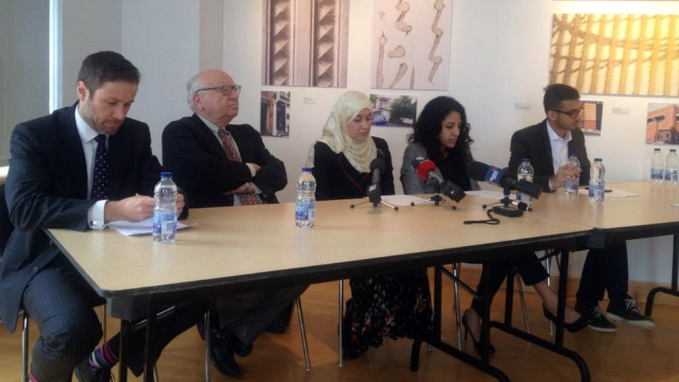 Rania El-Alloul is surrounded by her lawyers, including Julius Grey and Mathieu Bouchard, at a news conference on March 27, 2015 (CTV Montreal/Maya Johnson)
