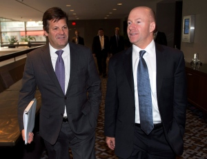 Bombardier Chairman Pierre Beaudoin, left, and chief executive Alain Belemare leave after a special shareholders meeting Friday, March 27, 2015 in Montreal. (Ryan Remiorz / THE CANADIAN PRESS)