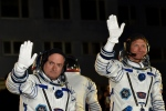 U.S. astronaut Scott Kelly, left, and Russian cosmonaut Gennady Padalka, crew members of the mission to the International Space Station, ISS, wave prior to the launch of Soyuz-FG rocket at the Russian-leased Baikonur cosmodrome, Kazakhstan, Friday, March 27, 2015. (AP / Kirill Kudryavtsev, Pool)
