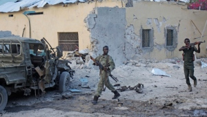 Somali soldiers take position after a bomb that was detonated at the gate of one of Mogadishu's most popular hotel. Friday, March, 27, 2015, A Somali police official says a suicide bomber has detonated his explosives-laden car at the gate of a hotel popular with government officials in Mogadishu. Capt. (AP / Farah Abdi Warsameh)
