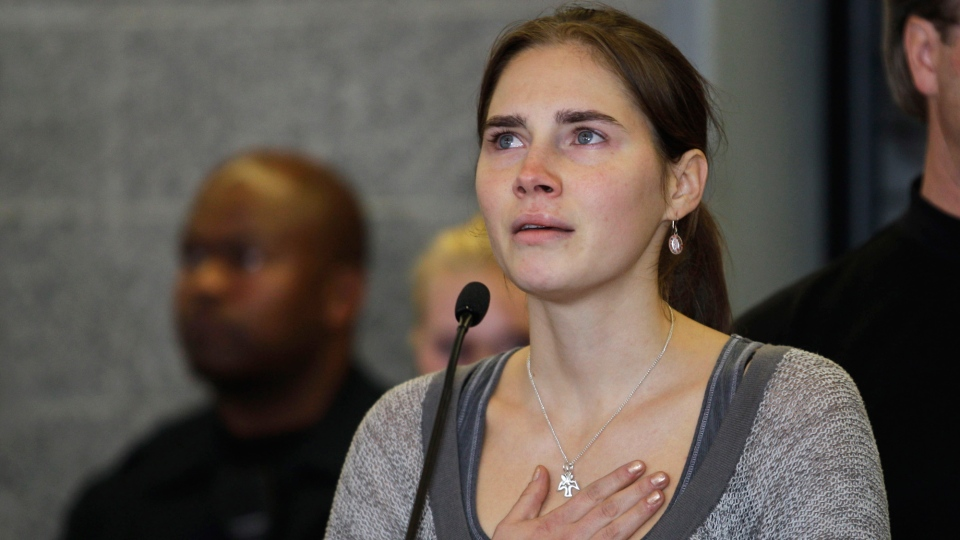 In this Oct. 4, 2011 photo Amanda Knox gestures at a news conference in Seattle, after returning home from Italy. (AP / Ted S. Warren)
