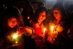 Young women attend a candlelight vigil during a gathering to observe Earth Hour in La Paz, Bolivia, Saturday March 29, 2014. Earth Hour takes place worldwide at 8:30 p.m. local time and is a global call to turn off lights for 60 minutes, as a symbolic act to raise awareness about climate change and to make people aware of everyday energy use. (AP /Juan Karita)