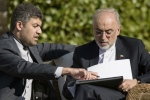 Head of Iranian Atomic Energy Organization Ali Akbar Salehi, right, looks at papers prior to meetings at the Beau Rivage Palace Hotel, in Lausanne, Switzerland, Saturday March 28, 2015. (AP / Brendan Smialowski)