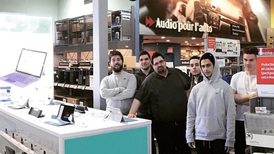 Future Shop employees pose for a photo after learning that their Quebec store has been closed on March 28, 2015. (Brendan Peddar / Instagram)