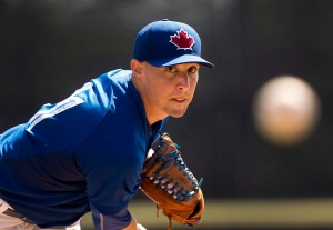 Toronto Blue Jays starting pitcher Aaron Sanchez warms up as he plays against the Pittsburgh Pirates during first inning Grapefruit League baseball action in Dunedin, Fla., on March 8, 2015. (Nathan Denette / The Canadian Press)