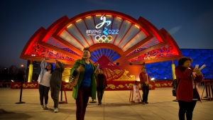 People take photos in front of a display for the proposed Beijing 2022 Winter Olympics on the Olympic Green in Beijing on March 28, 2015. The International Olympic Committee (IOC) concluded a 5-day visit on Saturday to inspect Beijing's bid for the 2022 Winter Olympics. (Mark Schiefelbein / AP Photo)