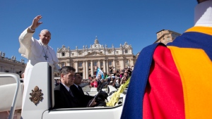 Pope Francis blesses the crowd as he leaves after a Palm Sunday Mass he celebrated in St. Peter's Square, at the Vatican, Sunday, March 29, 2015. (AP / Andrew Medichini)