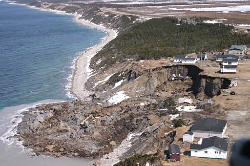Toppled houses areshown in Daniel's Harbour, Nfld., April 19, 2007. (CP / Aaron Beswick)