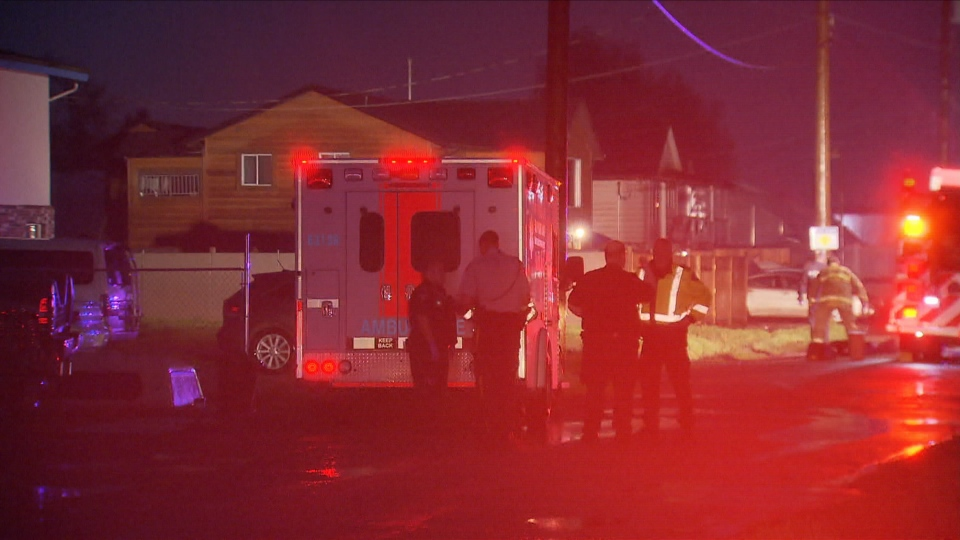 Mounties and ambulance paramedics respond to a fatal stabbing and police-involved shooting in Burnaby. March 29, 2015. (CTV)