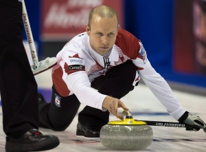 Team Canada skip Pat Simmons delivers a rock as they play Team USA at the men's World Curling Championships in Halifax on Saturday, March 28, 2015. (THE CANADIAN PRESS/Andrew Vaughan)