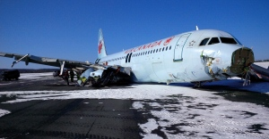 "This photo provided by the Transportation Safety Board of Canada shows a Air Canada Airbus A-320 at Halifax International Airport after making an ""abrupt"" landing and skidding off the runway in bad weather early on March 29, 2015. (The Transportation Safety Board of Canada / AP Photo)"