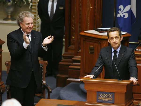 French President Nicolas Sarkozy, right, is applauded by Quebec Premier Jean Charest as he speaks to members of Quebec's National Assembly in Quebec City Friday, Oct. 17, 2008. (Jacques Boissinot / THE CANADIAN PRESS)