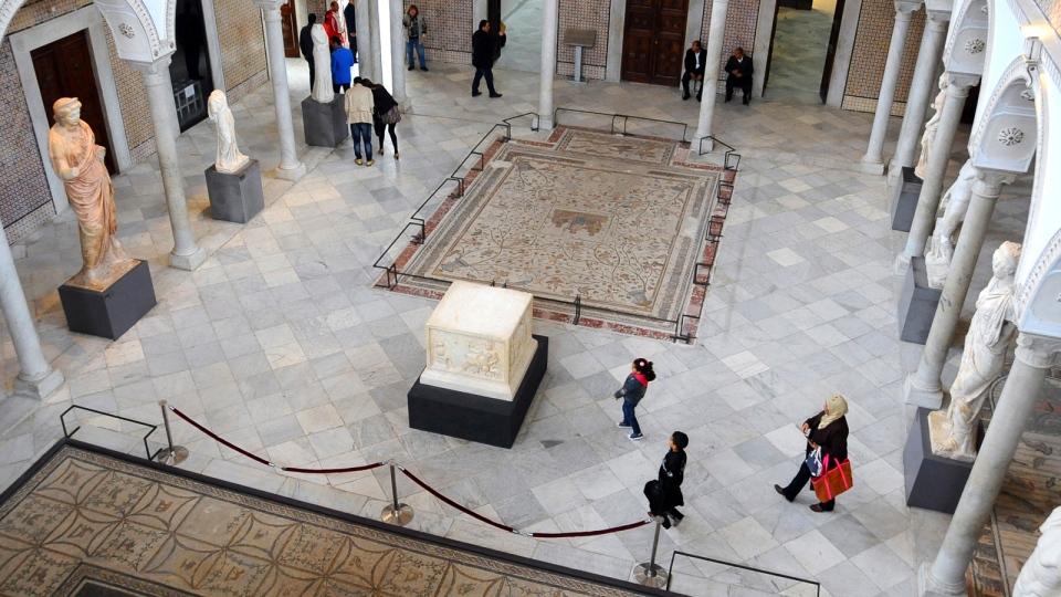 Tunisians stroll in Tunisia's National Bardo Museum Monday, March 30, 2015. (AP / Hassene Dridi)