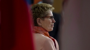 Ontario Premier Kathleen Wynne stands at the podium as the provincial government announces the launch of its new birth certificates in Toronto on Tuesday, March 10, 2015. (Chris Young / THE CANADIAN PRESS)