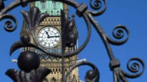 The Peace Tower is seen through the iron gates of Parliament Hill in Ottawa on Thursday, March 19, 2015. (Sean Kilpatrick / THE CANADIAN PRESS)