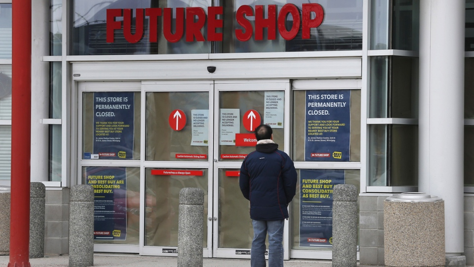 A Future Shop customer is turned away by closed signs at a store in Winnipeg, Saturday, March 28, 2015. (John Woods / THE CANADIAN PRESS)