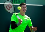 Milos Raonic, of Canada, returns the ball to Jeremy Chardy, of France, during their match at the Miami Open tennis tournament in Key Biscayne, Fla., Monday, March 30, 2015. (AP / J Pat Carter)