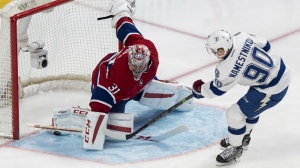 Tampa Bay Lightning's Vladislav Namestnikov scores past Montreal Canadiens goalie Carey Price during second period NHL hockey action in Montreal on March 30, 2015. (Paul Chiasson / THE CANADIAN PRESS )