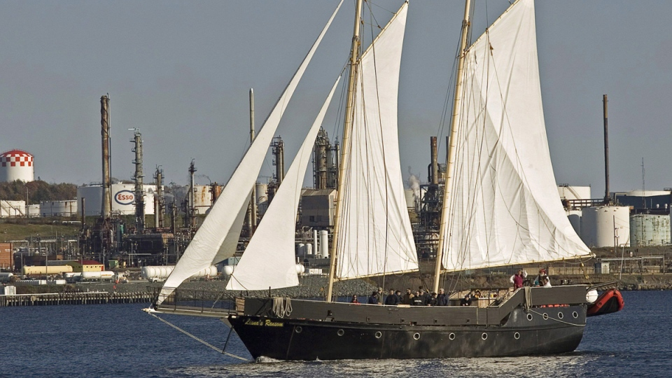 Liana's Ransom, an 85-foot gaff rigged, topsail schooner operated by Eastern Passage Privateers Schooner Company Ltd., sails past the Imperial Oil Dartmouth refinery in Halifax harbour on Oct. 31, 2007. (Andrew Vaughan / THE CANADIAN PRESS)
