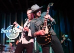 In this March 27, 2015 photo released by Hard Rock Cafe, Scott Weiland, left, performs with band mate Jeremy Brown, during an exclusive listening party at Hard Rock Cafe Hollywood in Los Angeles. (AP Photo/Hard Rock Cafe, Colin Young-Wolff)
