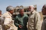 Hadi al-Amiri, centre, commander of Iraq's powerful Shiite militia, inspects his militiamen fighting against the Islamic State group in Tikrit, 130 kilometres north of Baghdad, Iraq, Wednesday, April 1, 2015. (AP Photo/Khalid Mohammed)