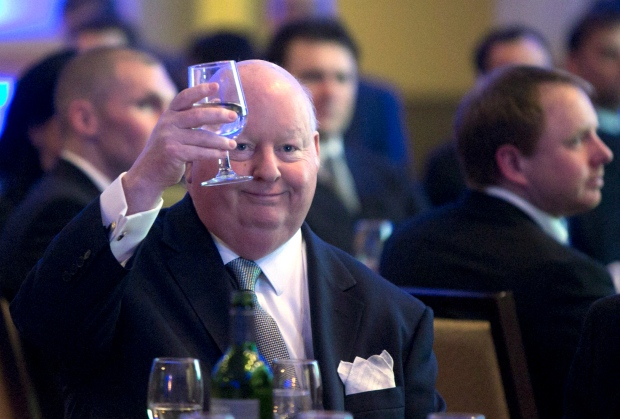 Senator Mike Duffy holds up his glass during the Maritime Energy Association's annual dinner in Halifax on Wednesday, Feb. 6, 2013. (THE CANADIAN PRESS / Devaan Ingraham)